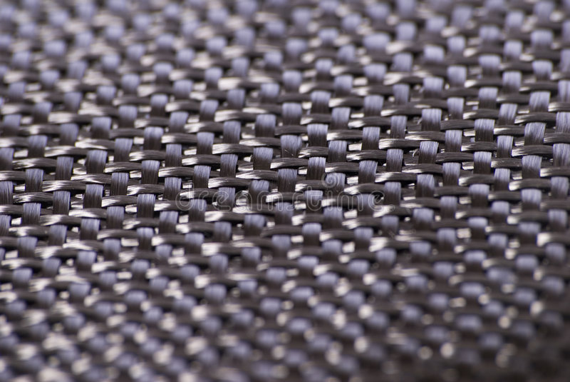Matéria têxtil do weave da fibra do carbono foto de stock