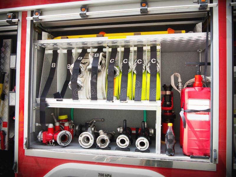 Matériel de camion de pompiers photographie stock libre de droits