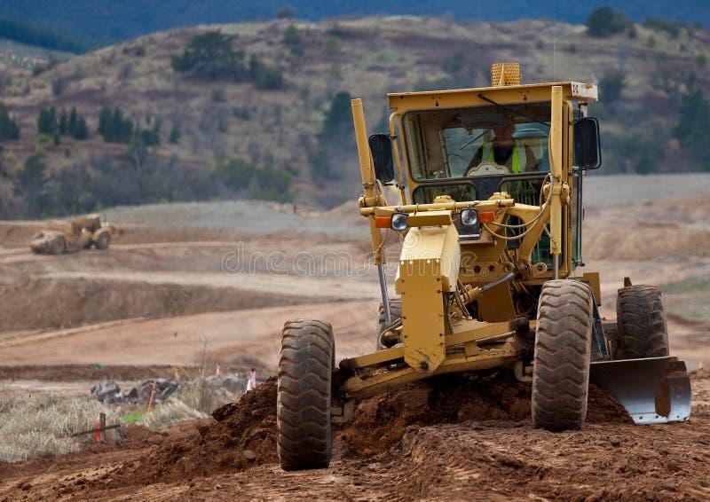 Matériel mobile de terre au travail photographie stock