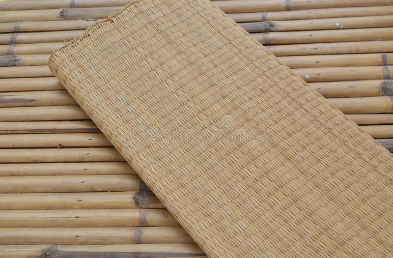 Mat on bamboo table stock photo