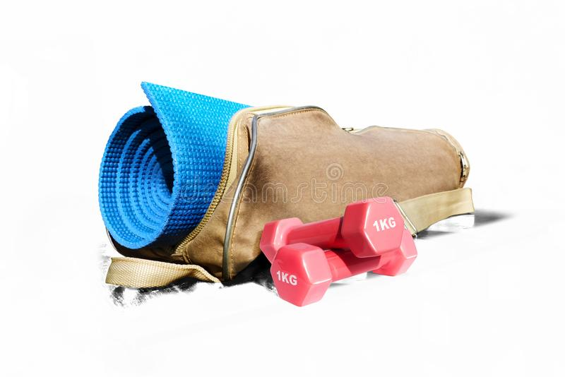 Mat for fitness and fitness pink dumbbells isolate on a white background stock photo