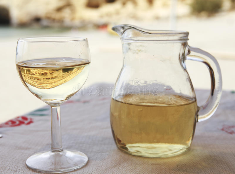 Matala reflection in white wine royalty free stock photos