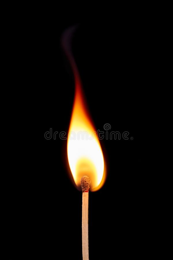Match on fire on a black background stock photos