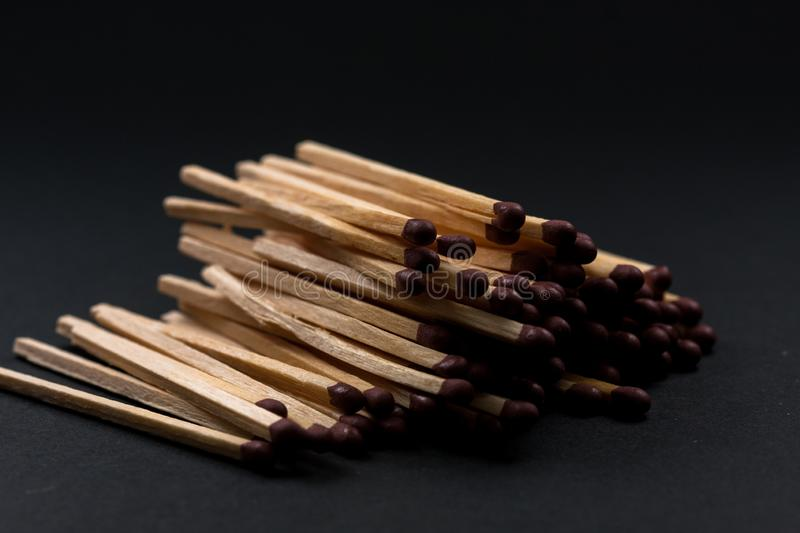 Match sticks accumulated on top of each other. Match sticks and black background stock photo