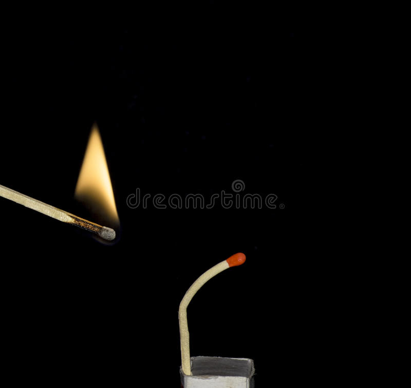 Match trying to avoid fire. Single match trying to avoid fire concept isolated on black royalty free stock photos