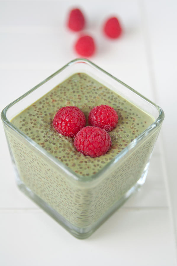 Matcha Chia Seeds Pudding with raspberry stock images
