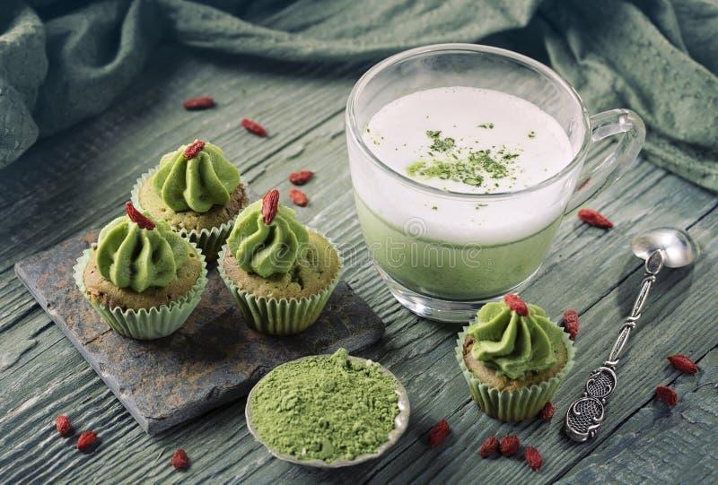 Matcha cup cakes and matcha latte royalty free stock photos