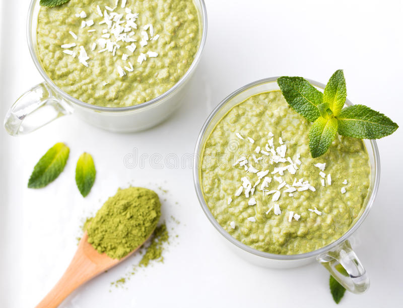 Matcha green tea chia seed pudding, dessert with fresh mint and coconut Healthy breakfast Top view Copy space. Matcha green tea chia seed pudding, dessert with royalty free stock photography