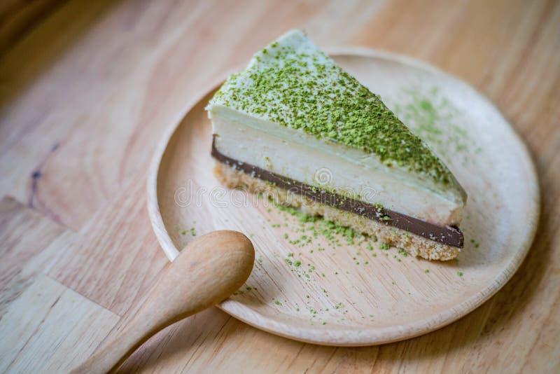 Matcha green tea and chocolate cheesecake stock photography