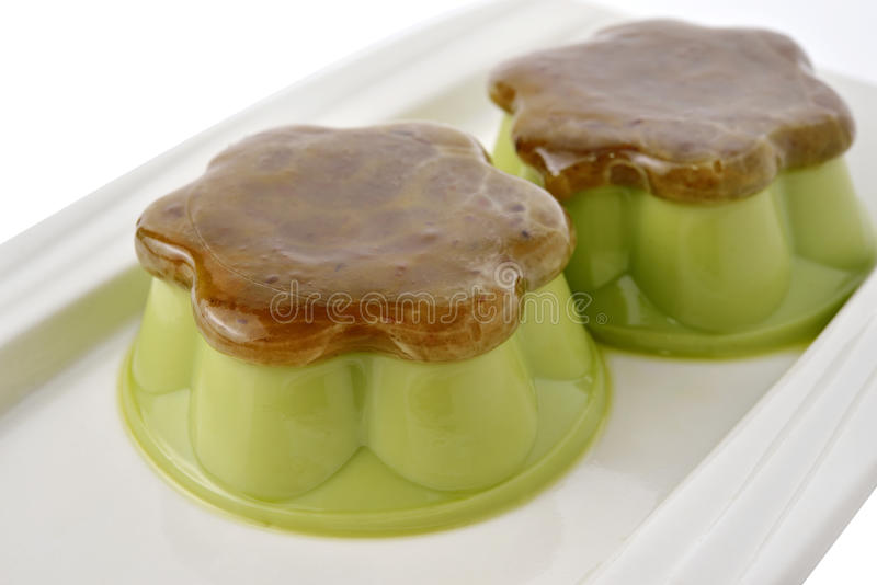 Matcha green tea custard with sweet minced red bean on plate royalty free stock photos