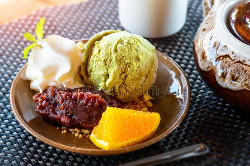 Matcha green tea ice cream with red bean stock images