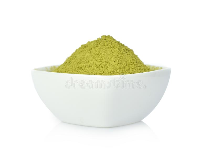 Matcha green tea Powder in white bowl on white backgorund royalty free stock photos