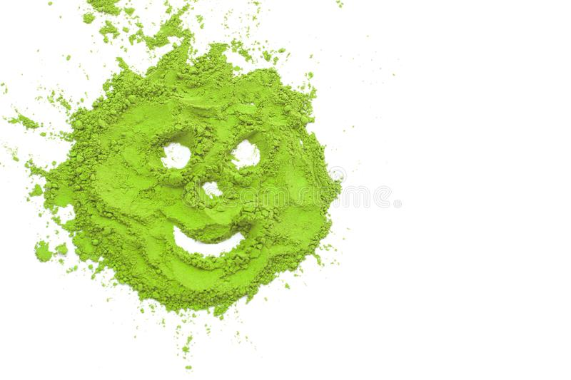 A spoon with powdered matcha green tea, isolated on white background, copy space, top view. Matcha green tea smile on a white background isolated. Smiling royalty free stock photography