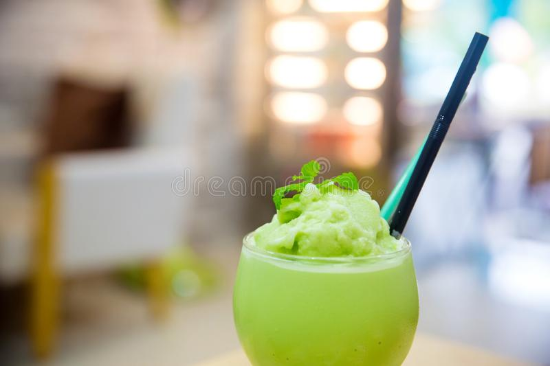 Matcha latte frappe glass with blur background. soft and blurr style. Close up matcha latte frappe glass with blur background. soft and blurr style. image for stock photo