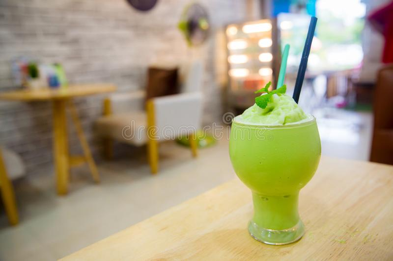 Matcha latte frappe glass with blur background. soft and blurr style. Close up matcha latte frappe glass with blur background. soft and blurr style. image for royalty free stock image