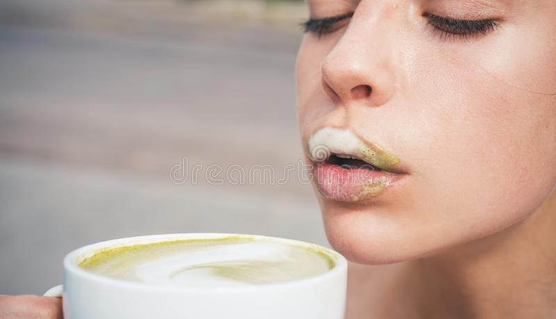 Matcha latte tea ceremony of girl. perfect morning with green coffee. woman drink japanese tea from cup. woman relax in. Cafe and drinking. it tastes delicious stock photography