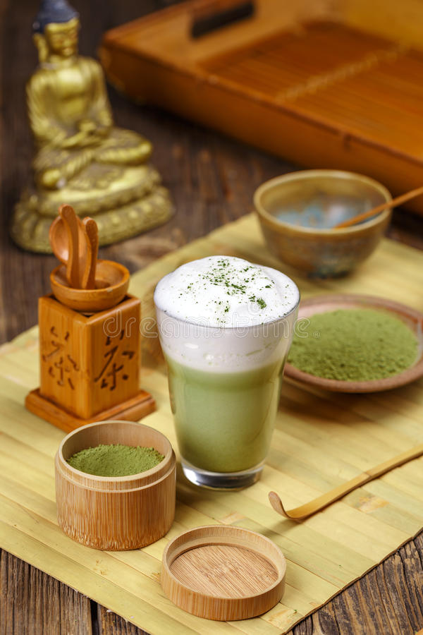Matcha tea latte in glass royalty free stock photo