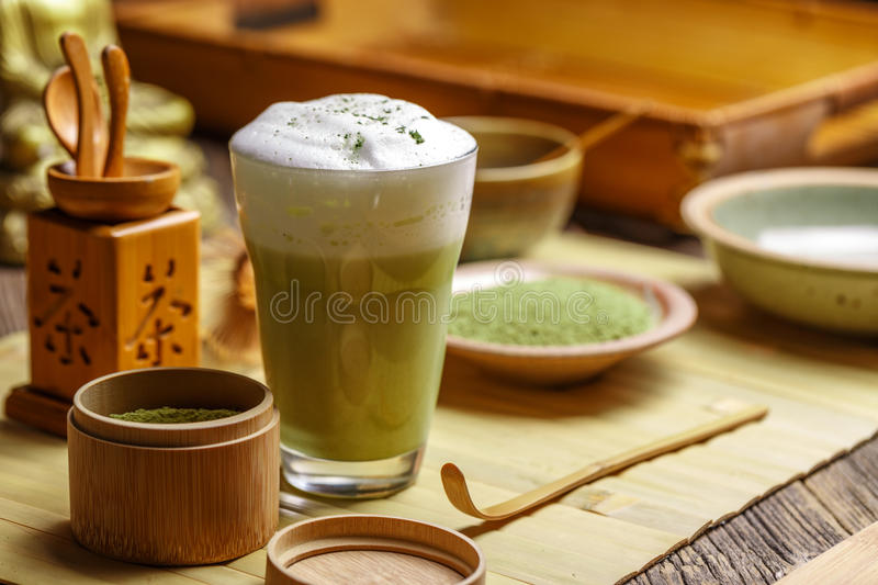 Matcha tea latte in glass stock photography