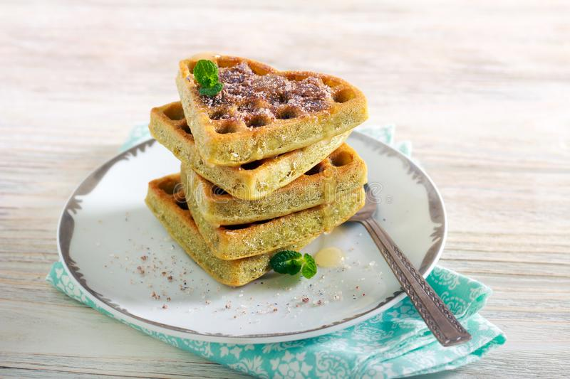 Matcha waffles with sweet topping stock photography