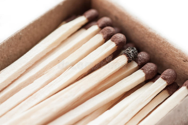 Matchbox and one burnt match. royalty free stock photos