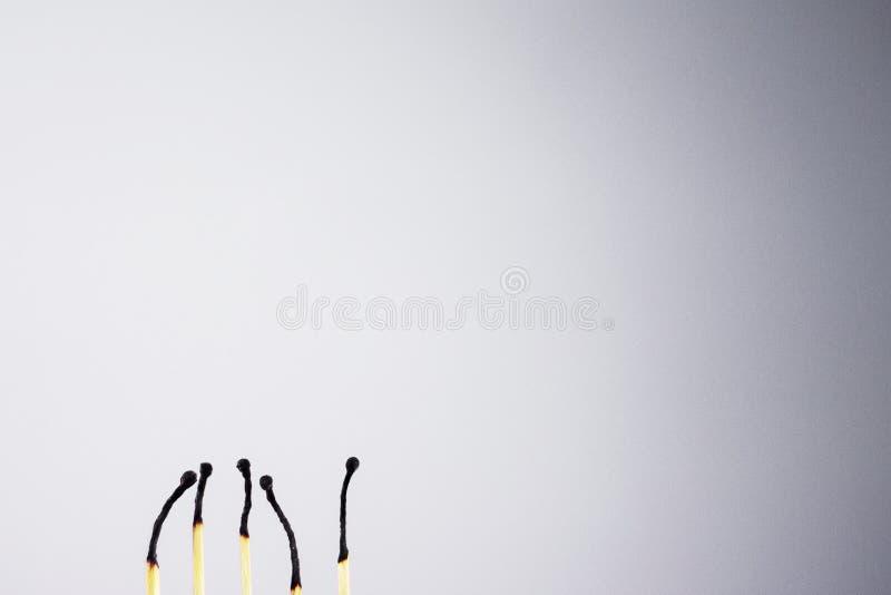 matches on black and white background. White background and match. Black background and match stock photo