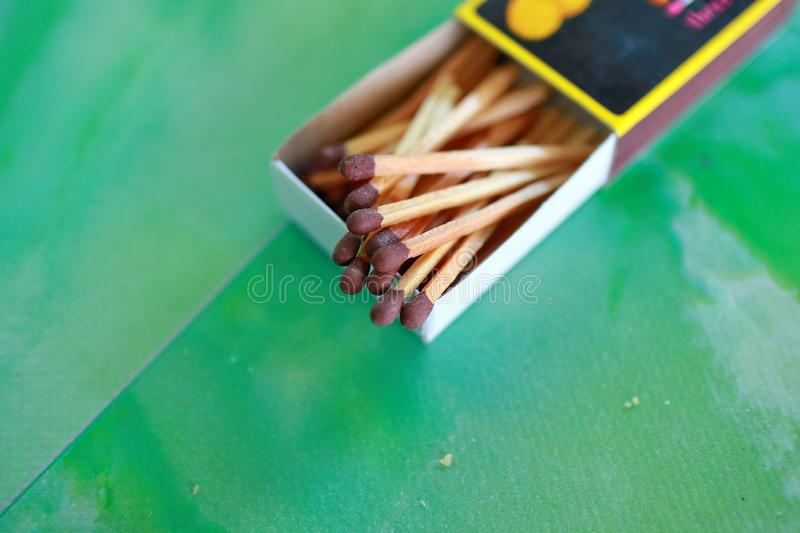Matches in box, green background. stock photography