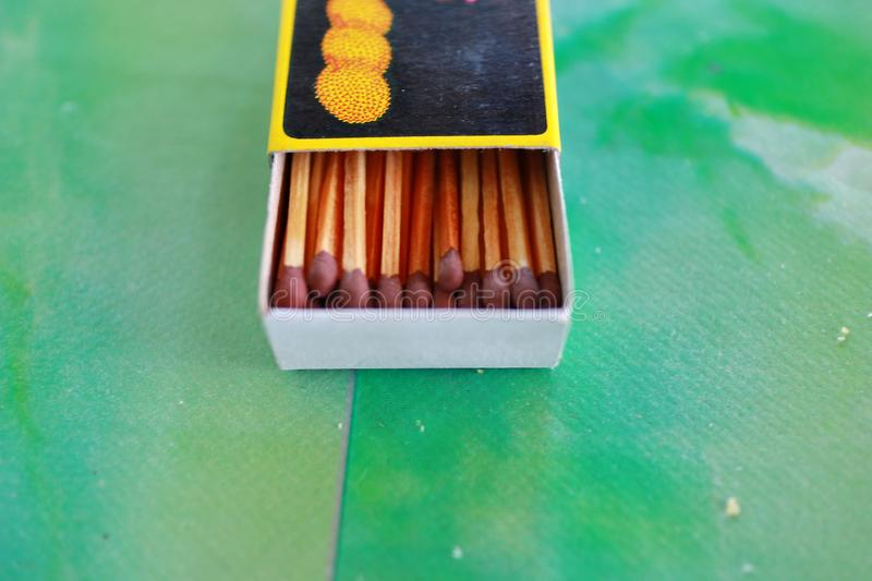 Matches in box, green background. royalty free stock photo