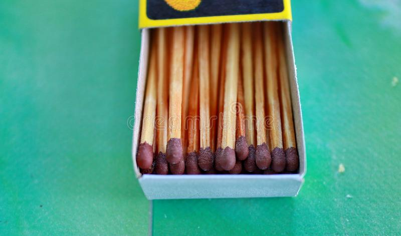 Matches in box, green background. stock photos