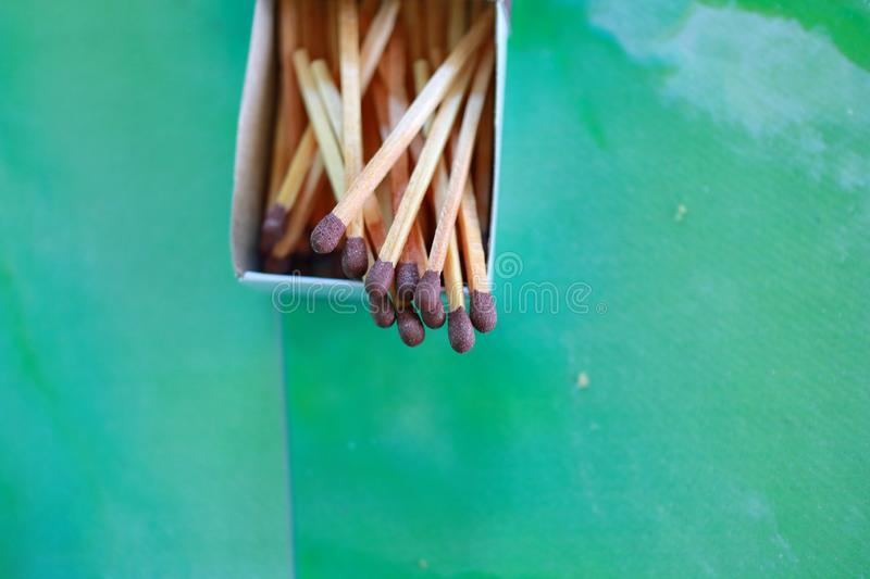 Matches in box, green background. royalty free stock image