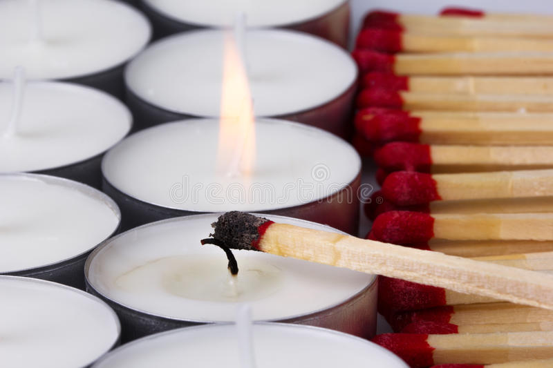Matches ignited white candles stock images