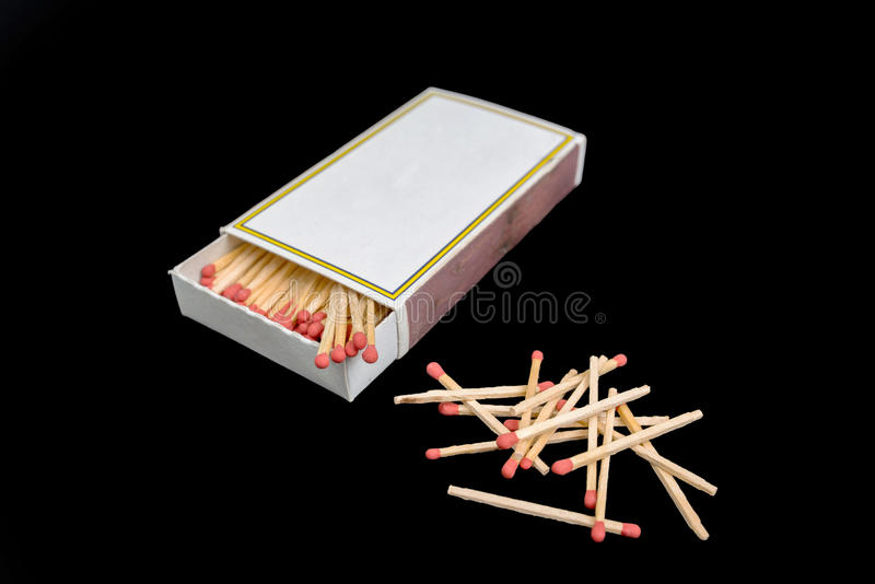 Matches and matchbox collection isolated on black background.  stock photos