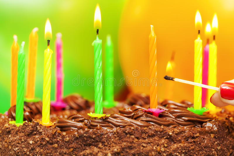 Matches near the candles. On the birthday cake stock photography