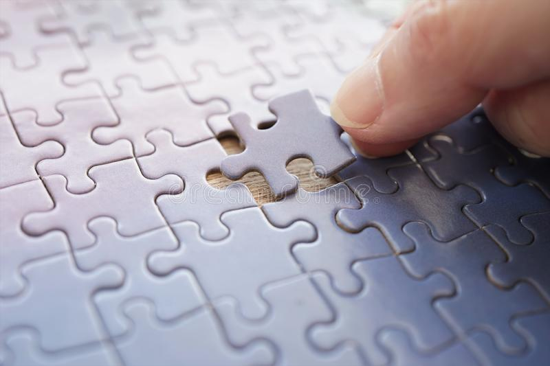 The matching last puzzle piece royalty free stock photo