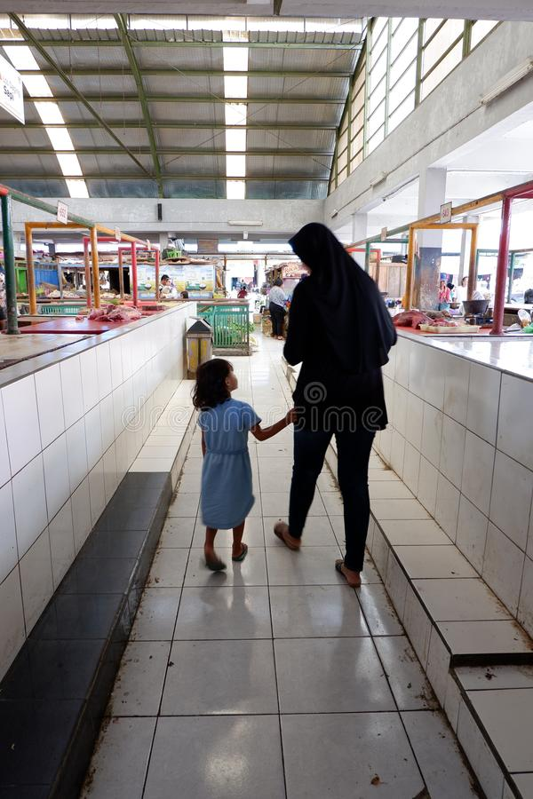 Rejowinangun, Magelang, Indonesia - 24 March 2019: matching mother and child when shopping in traditional markets royalty free stock image