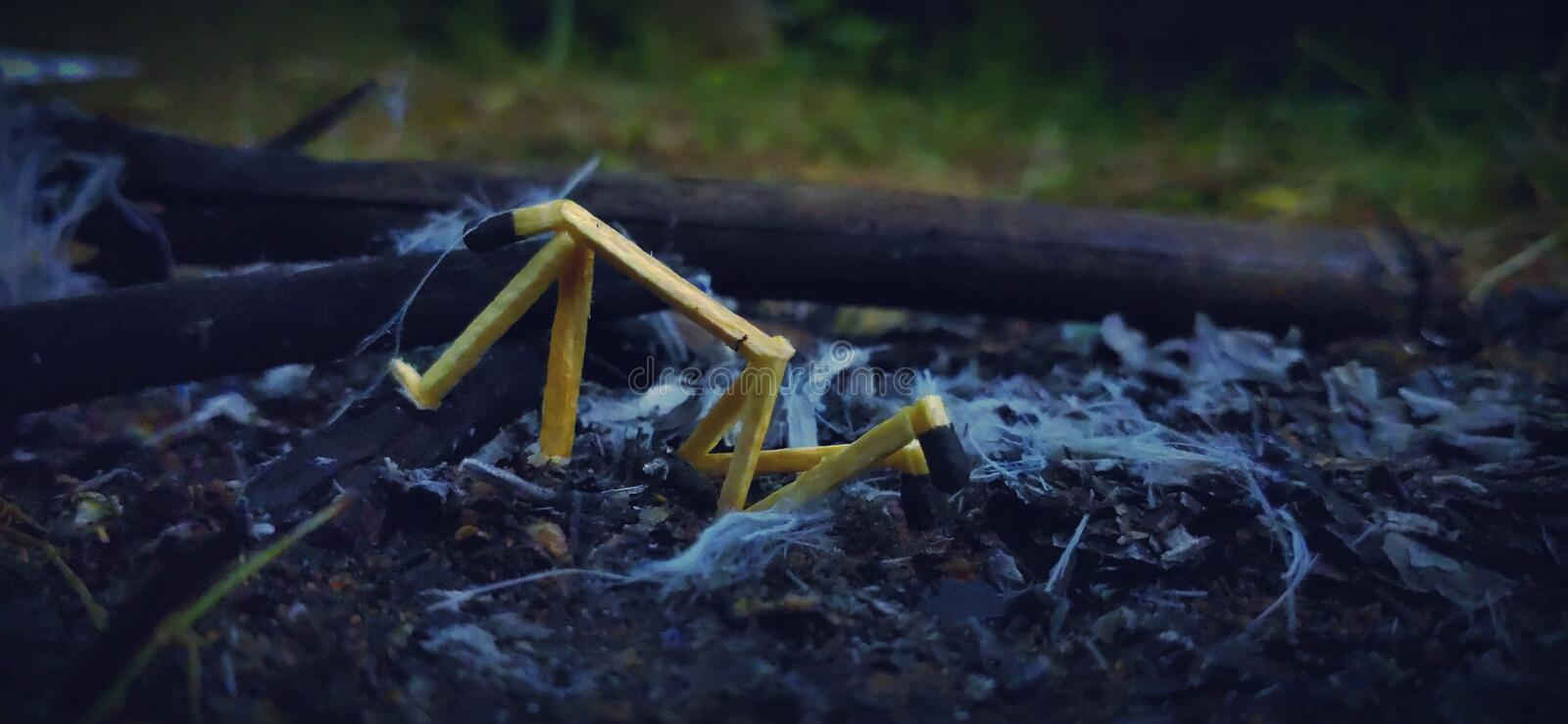Matchstick art. A stick man feels sad because his trees are burned into the fire. The image shows how nature is dying slowly. After the Amazon fire incident, it stock photos