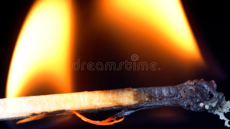 Matchstick burning. Revealing a sliver split out royalty free stock image
