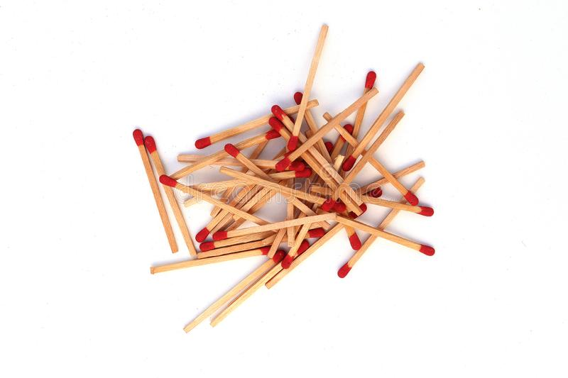 Matchstick  out of matchbox isolated on white background. High resolution image gallery stock photography