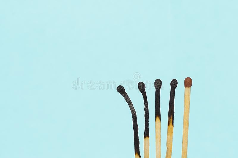 Matchsticks in different degrees of burning. Copy space. royalty free stock photos