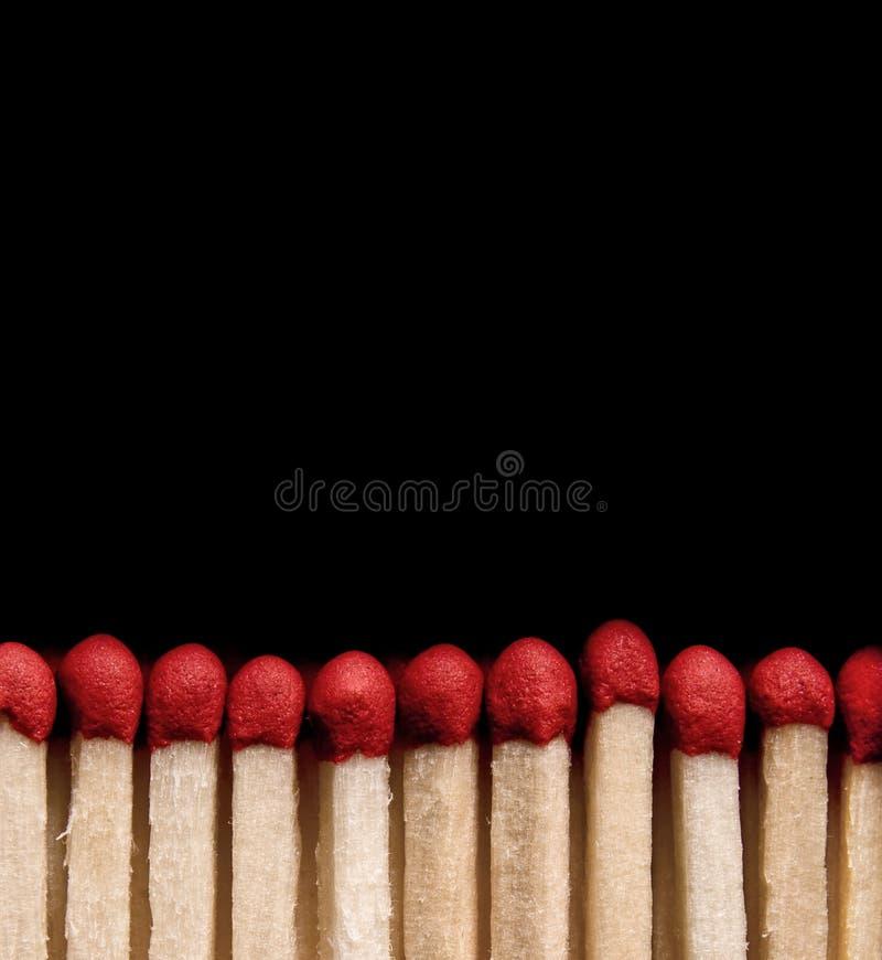 Matchsticks sul nero immagine stock