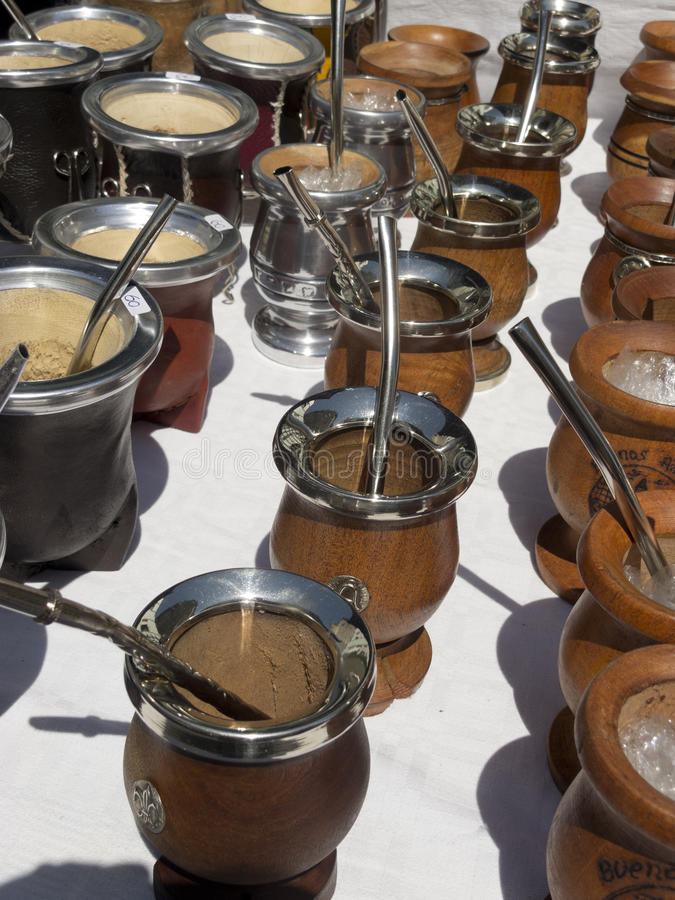 Mate calabash cups sale in Buenos Aires. Group of calabash matte cups with straws in Buenos Aires. Mate is a traditional drink very similar to tea in Argentina royalty free stock photography