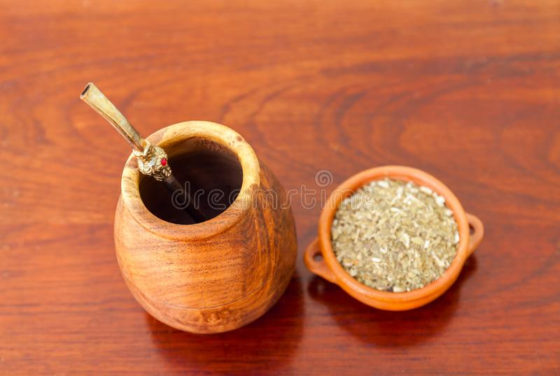 Mate Herb tea in a traditional calabash gourd with bombilla on a wooden table. Selective focus royalty free stock photos