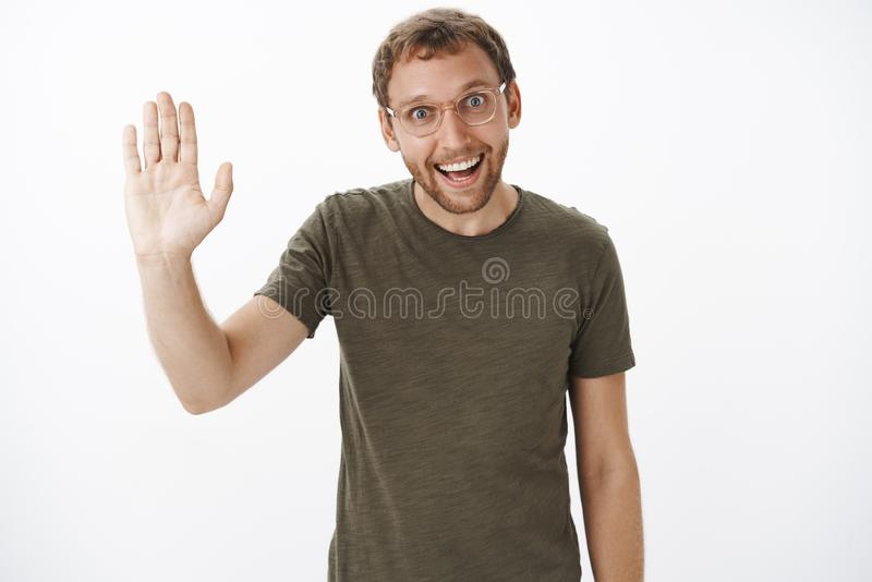 Mate high five we did it. Portrait of funny enthusiastic caucasian unshaven guy in dark-green t-shirt and transparent royalty free stock photography