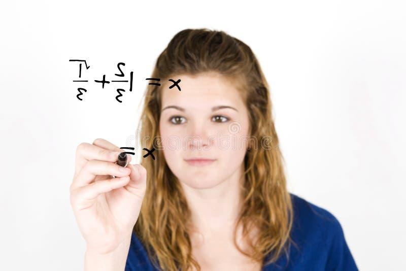 Matemática adolescente da menina foto de stock