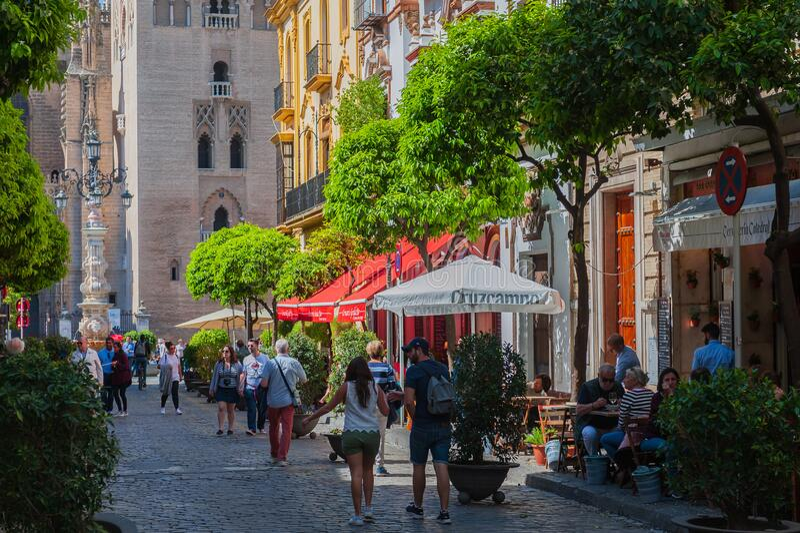 Mateos Gago street leading to La Giralda bell tower in Sevilla. royalty free stock photo