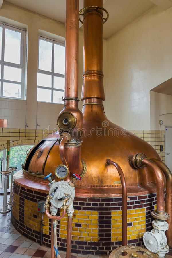 Mater, Belgium - April 29, 2017: Vintage copper kettle in brewer stock images