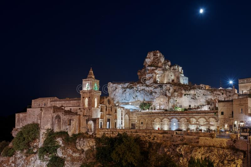 MATERA, BASILICATA, ITALY - September 7 , 2019.Night view at Church of San Pietro caveoso and on the top of the hill of Church of royalty free stock photo