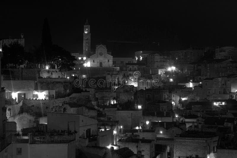 Matera in de nacht stock foto