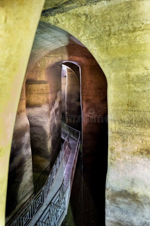 MATERA - BASILICATA - ITALY: inside Palombaro Lungo, the huge underground water system dug cistern of Matera. Matera old town, UNESCO World Heritage Site royalty free stock images
