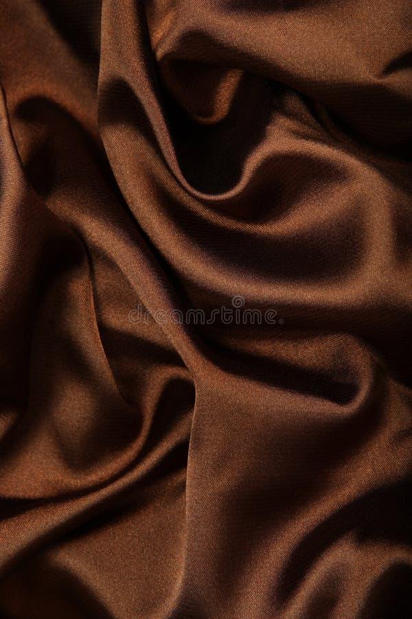 Materia textil de la seda de Brown fotografía de archivo