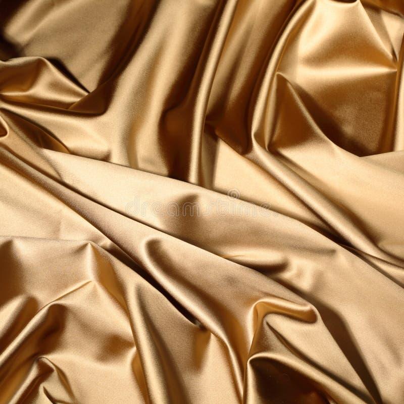 Materia textil del oro imagen de archivo libre de regalías